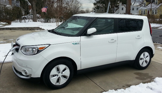 White Kia Soul EV blends well with the snow