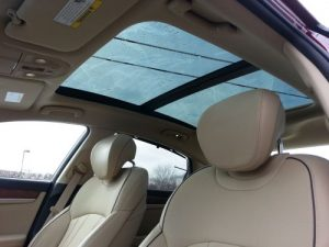 Expansive panoramic roof with power sunshade that helps block glare up front