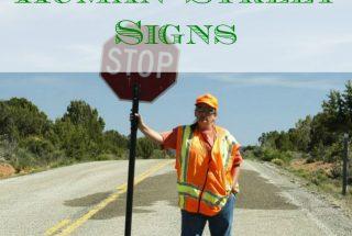 retailers, human street signs, advertisement tips