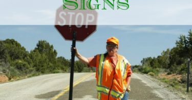 retailers, human street signs, advertisement tips